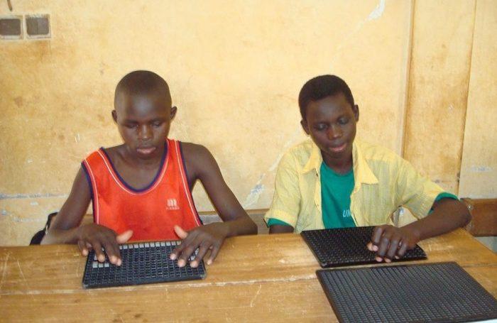 Students learning braille in Uganda
