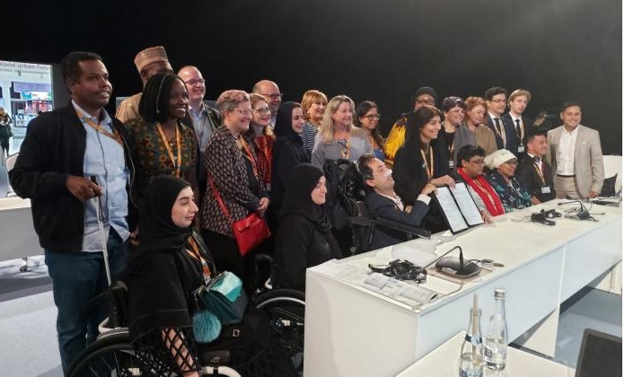 Group Photo WUF10 roundtable on Persons with Disabilities: WUF10 Roundtable on Persons with Disabilities. WBU coordinated the delegation of persons with disabilities under the auspice of the General Assembly of Partners PCG of Persons with Disabilities. World Enabled coordinated the presence of the Global Network for Disability-Inclusive & Accessible Urban Development (DIAUD) and signatory cities & organisations to the Global Compact on Inclusive and Accessible Cities.